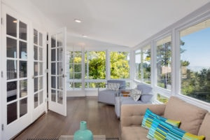 Bright solarium-style sunroom off the master suite. Casement Windows - Royal Windows